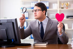 The businessman in saint valentine concept in office Stock Photography