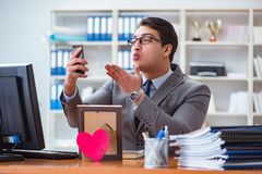 The businessman in saint valentine concept in office Stock Images