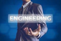 Businessman or Salaryman with ENGINEERING text modern interface. Concept Stock Photos