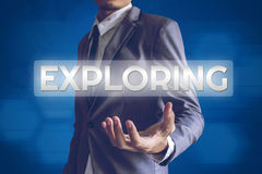 Businessman or Salaryman with Exploring text modern interface co. Ncept Royalty Free Stock Images