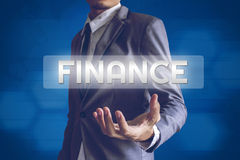 Businessman or Salaryman with FINANCE text modern interface conc. Ept Royalty Free Stock Image