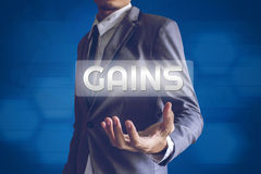 Businessman or Salaryman with Gains text modern interface concep. T Stock Photo