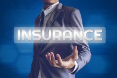 Businessman or Salaryman with insurance text modern interface co royalty free stock image
