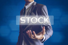 Businessman or Salaryman with STOCK text modern interface concep. T Royalty Free Stock Images