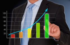 Businessman with sales graph Royalty Free Stock Photo