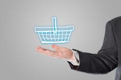 Businessman, salesman, basket symbol in the hand. Salesman, businessman presented a symbol in his hand stock photos