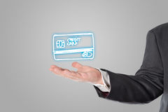 Businessman, salesman, credit card symbol in the hand