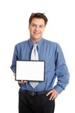 Businessman or salesman holding sign. A businessman or salesman holds up a blank sign or chart stock photography