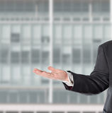 Businessman, salesman,. Salesman presented the product in his hand stock image