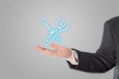 Businessman, salesman, tool symbol in the hand. Salesman, businessman presented a symbol in his hand royalty free stock image