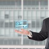 Businessman, salesman, with a virtual symbol (credit card). Salesman presented a virtual symbol in his hand stock photo