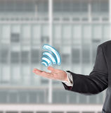 Businessman, salesman, with a virtual symbol (wifi)