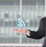 Businessman, salesman, with a virtual symbol (wifi) Stock Photography