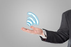 Businessman, salesman, wifi symbol in the hand Stock Photo