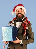 Businessman in Santa cap with giftbox and garland royalty free stock photography