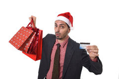 Businessman in Santa Claus Christmas hat holding sopping bags and credit card in worried and stress Stock Images