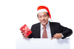 Businessman in a Santa Claus hat Stock Image