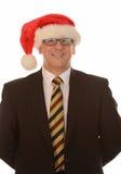 Businessman in Santa hat Stock Images