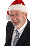 Businessman with Santa hat. Happy middle aged businessman with Santa Claus hat; isolated on white background Royalty Free Stock Image