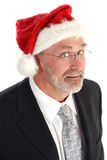 Businessman with Santa hat. Middle aged or mature businessman with Santa Claus hat; isolated on white background Royalty Free Stock Images