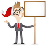Businessman with santa hat and blank sign Royalty Free Stock Image