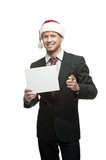 Businessman in santa hat holding sign Royalty Free Stock Images