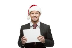 Businessman in santa hat holding sign Royalty Free Stock Image