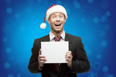 Businessman in santa hat holding sign Royalty Free Stock Photos