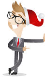 Businessman with santa hat, leaning and pointing Royalty Free Stock Image