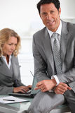 Businessman sat with colleague Royalty Free Stock Photo