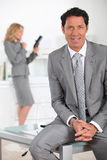Businessman sat on table Royalty Free Stock Photos