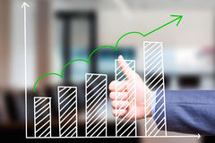 Businessman is satisfied with  Growth Graph. Sales concept. Thum. Bs Up. Stock Image. Isolated on office Royalty Free Stock Images