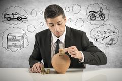 Businessman save money Stock Image