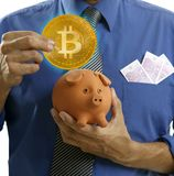 Businessman saving Bitcoin BTC in piggy bank Stock Photo