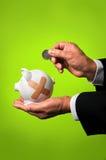 Businessman Saving Coin Royalty Free Stock Photography