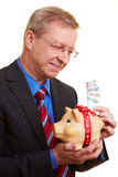 Businessman saving Euro banknotes Royalty Free Stock Images