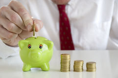 Businessman saving money Stock Photos