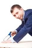 Businessman with a saw Royalty Free Stock Photography