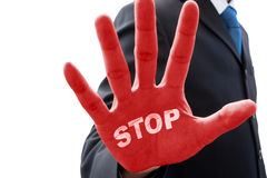 Businessman saying. Businessman in dark gray suit raise his hand in action of stop and words ' stop ' on his red palm Royalty Free Stock Photography