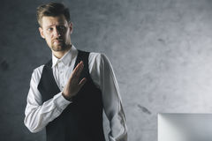 Businessman saying no. Young businessman saying no with hand on concrete background Stock Photography