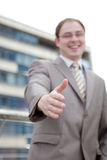 Businessman saying welcome - handshake. (outdoor the office Stock Photo