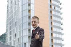 Businessman saying welcome - handshake. (outdoor the office Royalty Free Stock Photography