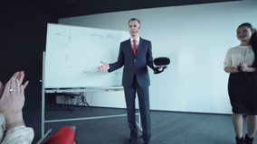 Businessman says showing charts on a whiteboard stock footage