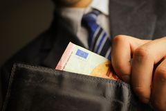 Businessman in the scam emit money from the wallet. Europe money royalty free stock photos