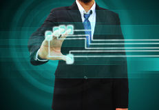 Businessman scanning  finger on a touch screen interface Royalty Free Stock Photography