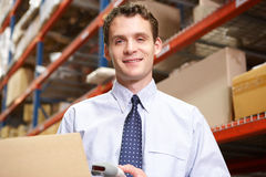 Businessman Scanning Package In Warehouse Stock Photography