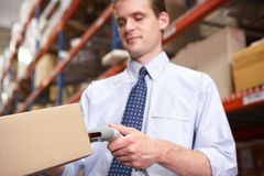 Businessman Scanning Package In Warehouse Stock Photos