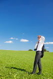 Businessman scanning the skies Royalty Free Stock Photo
