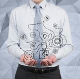 Businessman scheme. Businessman holding social media diagram on gray background Stock Photo
