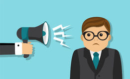 Businessman scolded into a megaphone Stock Photos